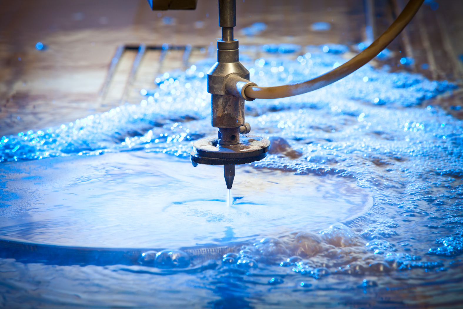 Water-jet Machine at work cutting a steel plate. Detail.